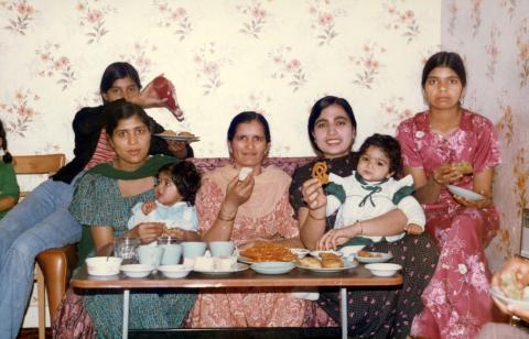 A family celebrate a birthday at home with a Punjabi meal, (Wolverhampton, 1979). Image courtesy of Black Country Visual Arts CIC