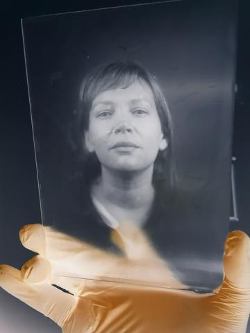 Photo of Debbie Cooper on glass plate